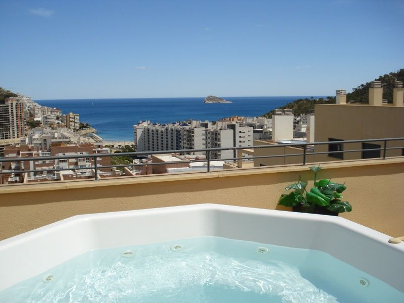 Enjoy stunning sea views from the roof top terrace and hot tub Jacuzzi at Penthouse La Cala.