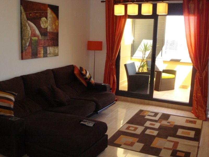 Patio doors lead out to the balcony - terrace area furnished with seating to enjoy the sea views.
