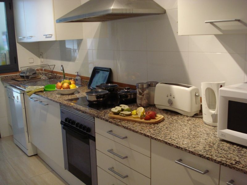A fully equipped kitchen with everything for your holidays or long winter stays, including dishwasher and washing machine.